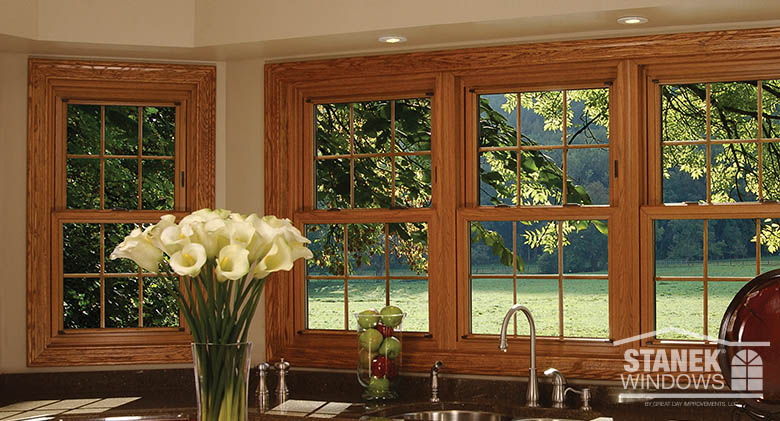 Double-hung windows with woodgrain finish and colonial grids