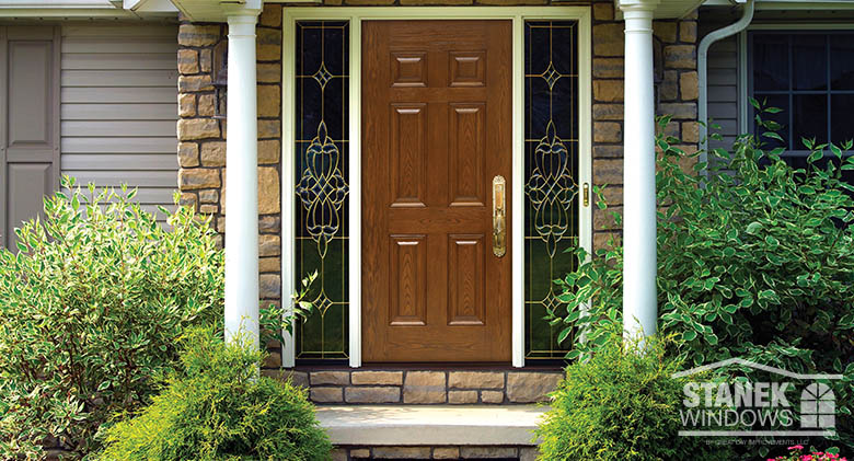 entry door in an oak finish with sidelights