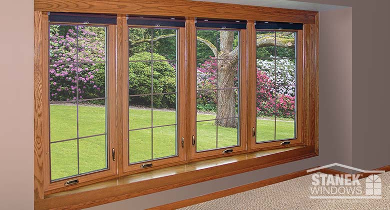 Four-lite bow window with interior woodgrain finish and interior colonial grids.