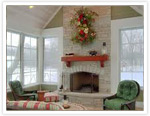 Large, traditional fireplace in a sunroom