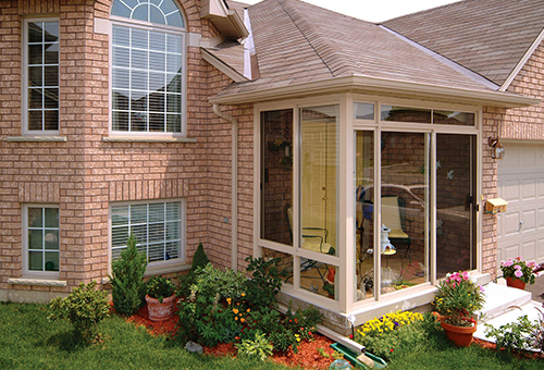 Outside View of a Small Sunroom Under Existing Roof