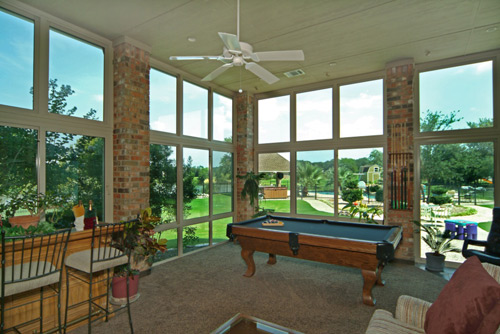 Inside View Of A Very Large Sunroom Under Existing Roof With Pool Table U0026  Bar