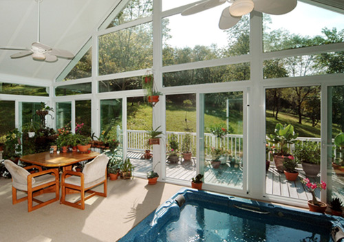 Inside View Of A Sunroom With Vaulted Ceiling And Hot Tub