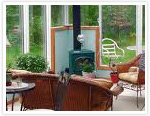 Simple sunroom fireplace in a solarium.
