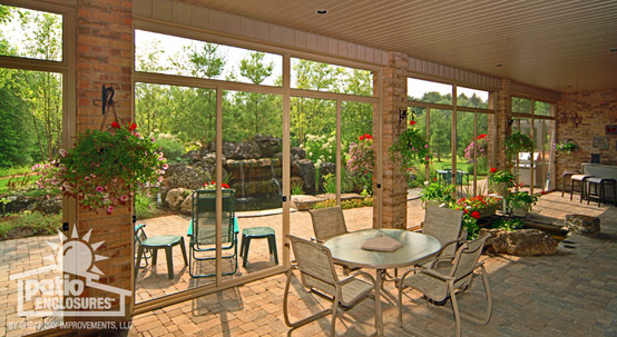 Screened-in porch with beautiful floral arrangements
