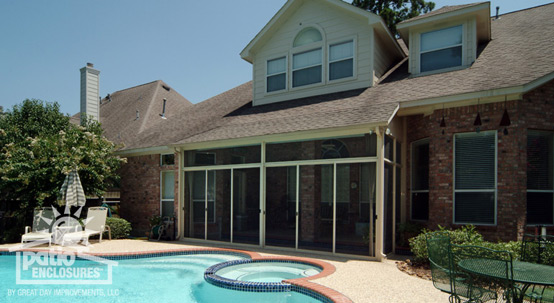Screened porch next to a beautiful outdoor pool
