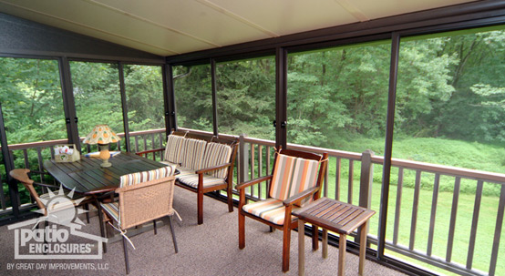Screened-in porch with gorgeous striped furniture
