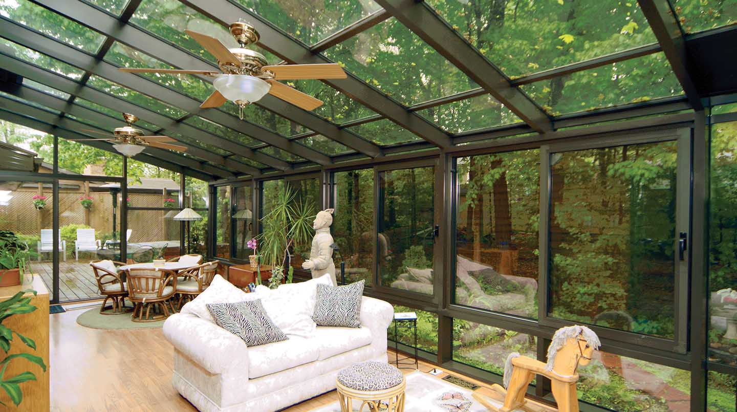 Glass solariums glass rooms spa pool enclosures for Backyard sunroom