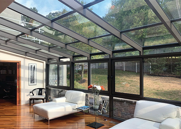 patio enclosures solariums provide floor to ceiling views of the outdoors with glass walls and roofs - Glass Enclosures